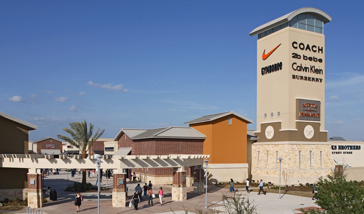 Houston Premium Outlets in Cypress, Texas is a southwestern style, modern and fashion-forward outlet mall in the Cypress area, just outside of Houston. The mall's exterior reflects classical types of south-western architecture to emphasize the history of the town of Cypress, with store lights that complement a calm and soothing atmosphere.